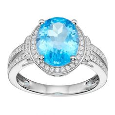 Sterling Silver 11 mm x 9 mm Blue Topaz & Lab-Created White Sapphire Halo Ring Featuring an oval-cut genuine blue topaz center stone encompassed with lab-created white sapphire accents, this halo ring abounds with elegant appeal. Blue Topaz Ring, White Sapphire, Sapphire Rings, Halo Rings, Stone Rings, Filigree Jewelry, Filigree Ring, Jewelry Rings, Jewellery