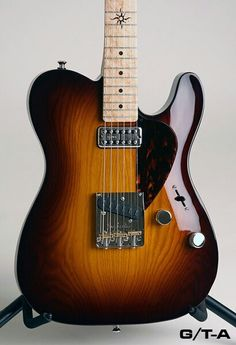 Gorgeous Ron Thorn Tele-style example. Finely crafted customs...$$$...but looks worth price.