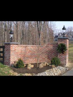 Brick driveway entrance.