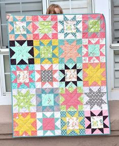 I love star quilts! I need to remember that the background doesn't always need to be white. This quilt makes me want to get out of my comfort zone!