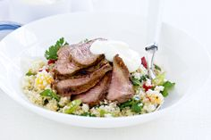 Tangy yoghurt is great with aromatic seasoned lamb and a salad that's full of crunch and flavour. What's more, this dish is low fat and ready in no time.