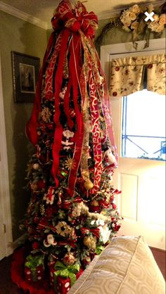 Beautiful GeauxBows Bow Atop this beautiful tree my Customer Susan used as part of her decor! Thank you Susan