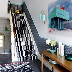 """I'm not sure whether to be drawn or repulsed by this scheme (mixed emotions).  It certainly is an interesting geometric style and the dado high wall print acts to draw the eye and visually lengthen the space. Wallpaper """"Turnell & Gigon"""", Stair Runner """"Crucial Trading"""""""