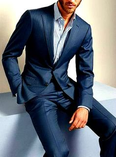 Well tailored blue suit with striped white and blue shirt. Great look...