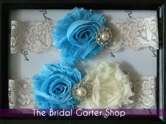 Wedding Garter in an ivory stretch lace with baby blue and ivory chiffon flower. $25.00, via Etsy.