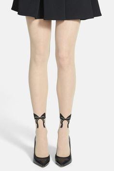 fashion-tights.net Add a stunning twist to your ensemble with retro-inspired sheer tights detailed by a glamorous back seam that twists into darling tattoo-effect bows at the ankle.