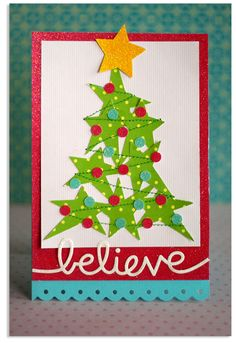 Use a star punch for the tree, and a regular hole punch for the ornaments!  Then use a zigzag stitch to tie it all together!