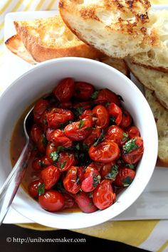 #paleo Roasted Tomato Bruschetta: 1 (16 ounce) box of grape tomatoes; 3 cloves garlic, leave 1 minced and 2 whole; 1/4 cup of extra virgin olive oil; salt and pepper to season; 1 tablespoon of olive oil; SKIP the ciabatta; 1/4 cup of fresh basil, shredded; 1/4 cup of fresh Italian parsley, chopped; OPTIONAL: 1/4 cup of fresh mint, chopped