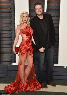 Hot couple! Gwen Stefani and Blake Shelton held hands as they arrived at the vanity Fair O...