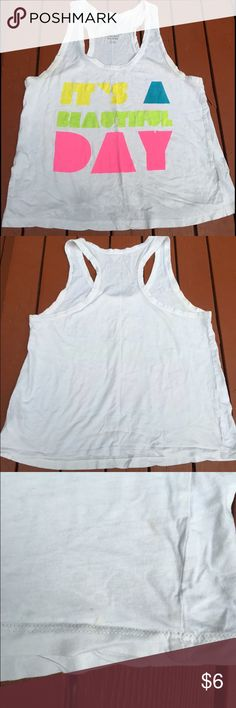 SALE✨It's a beautiful day White tank with minor flaws. Small stain and hole. Size large and from forever 21. All flaws shown. Yellow, blue, green, white, pink... Summer top! Forever 21 Tops