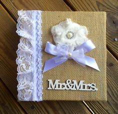 A personal favorite from my Etsy shop https://www.etsy.com/listing/451592142/burlap-lace-wedding-album-mr-mrs-album