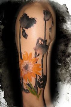 I don't know if I'll ever find a sunflower tattoo that I actually like, but here's a good start...