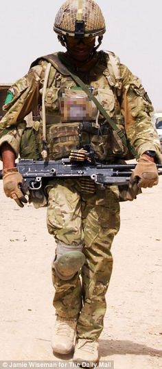 A British soldier on patrol in the village of Chah e-Anjir in Helmand.