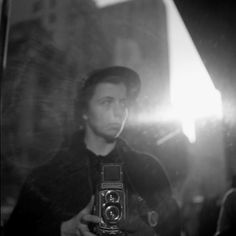 Photographer: Vivian Maier self portrait photo series.   One of my strongest inspirations right now. I love street photography; the discovery of her story and work is more and more fascinating to me each photo I see.