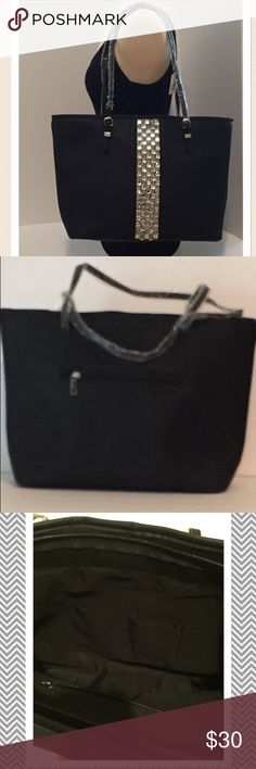 """New Black Shoulder Tote Bag This Tote has a stripe of rhinestones down the front. Back has a zipper compartment. Zipper closure. Two handles silver-tone hardware. Very roomy inside with two open compartments and one zipper compartment. Outside is a faux leather with nylon lining. Approx measurements:  18"""" L x 11"""" H x 5 1/2"""" D. 🚫🚫🚫No Trades, MY PRICES ARE FIRM, they are very reasonable Bags Totes"""