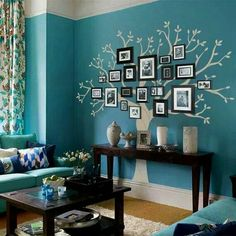 Amazing family photo tree. I love this color! I'm doing this in my living room.