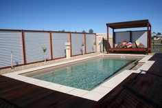 The Symphony pool is a stylish, contemporary fibreglass swimming pool. Visit Narellan Pools to get a free quote from a qualified swimming pool builder. Outdoor Landscaping, Backyard Patio, Backyard Ideas, Fiberglass Swimming Pools, Real Estate Buyers, Pool Cabana, Pool Lounge, Modern Pools, Pool Builders