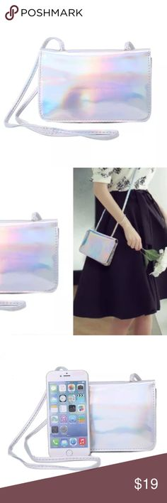 🌈💫Holographic Cross Body Bag💫🌈 2 Left❣️ 🌈💫Holographic Cross Body Bag💫🌈 Brand New❣️ perfect for some bling when you don't need to carry a heavy satchel ☺️ on a night out. Strap included separately sealed in shipping case. Perfect size for a phone and accessories. Galactic mini-purse 💫💋 Faux / Vegan leather with polyester lining. pearl stash Bags Crossbody Bags