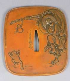 A JAPANESE COPPER TSUBA WITH NBTHK CERTIFICATE- SHOJO AND TOAD