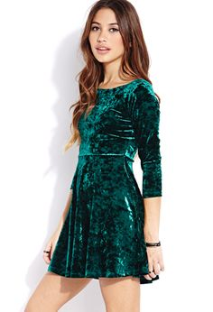 This velveteen dress would be fun with a gold sparkly bow belt and black tights for a holiday party!