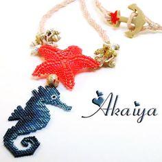 ️Collier réalisé suite au défi #dessinemoilamer Étoile de mer en peyote et herringbone, Hippocampe en brick stitch d'après un schéma que j'ai réalisé, cordon en kumihimo et fermoir et perle de jonction en argile polymère.️#collier #necklace #collar #hippocampe #seahorse #etoiledemer #starfish #perles #beads #miyuki #miyukibeads #miyukidelica #miyukiaddict #coquillage #shell #cordon #kumihimo #perlesandco #faitmain #handmade #bijoux #bijouxfaitmain #jewelry #jewellery #pol...