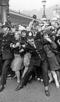 'Beatlemania' In Front of Buckingham Palace, London, circa 1964.