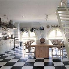 I've always wanted a black and white kitchen.