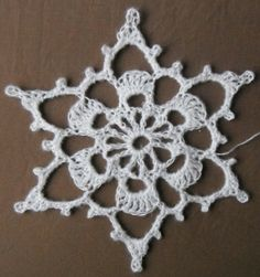 big crocheted snowflake.   Makes a very sweet snowflake with No. 10 Crochet Thread.