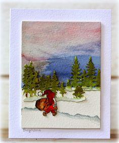 handmade Christmas card from Rapport från ett skrivbord: Pyssloteket ... winter scene ... watercolor wash sky ... small die cut trees water colored and layered ... small Santa figure ... luv Birgit's artistry ...