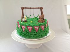 Swing set cake. White chocolate cake and buttercream with gumpaste and fondant swing set, seagull and squirrel.  Banner is all fondant.