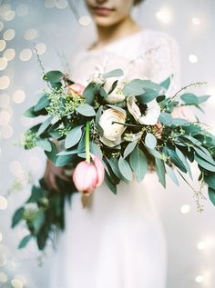 A lovely, leafy bouquet of tulips, anemones, ranunculi, and eucalyptus | Photo by Peaches & Mint | Floral design by Flowerup