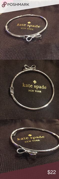 Kate Spade Bow Bangle Silver bow bangle by kate spade. EUC. Magnetic clasp. No trades please. kate spade Jewelry Bracelets