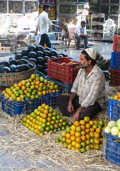 Fruit-seller at a Road-side Fruit-stand, Mumbai (Bombay), Maharashtra, India