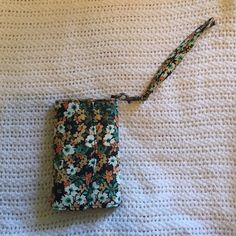Floral Wristlet Great condition! Does have a slot for an iPhone 4/4s (may be able to fit the 5 but I'm not sure- definitely not the 6)... However, that section is pretty flat so you could store something else there too! Bags Clutches & Wristlets