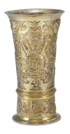 POSSIBLY VALENTINUS (FELTEN) URBIGER SILVER-GILT BEAKER,  chased with a lion rampant, a stag and a rearing horse within auricular cartouches below boys' heads, similarly decorated above the base with a grazing rabbit between a stag-chasing hound, maker's mark only  poorly struck,  Brasov (Kronstadt), circa 1650