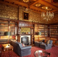 The fireplace side of the Library at Knightshayes Court, Devon