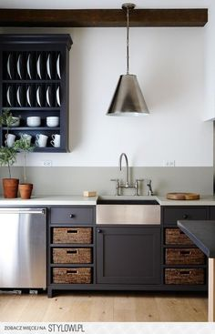 Stainless farmhouse sink with black cabinets is nice. #kitchen