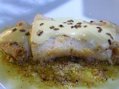 Lenguado rebozado en almendras y salsa de limón.