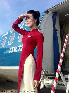 Vietnamese air hostess welcomes you to Vietnam Airline Cabin Crew, Vietnam Airlines, Airline Uniforms, Vietnam Voyage, Flight Attendant Life, Female Pilot, Uniform Design, Attendance, Lady V