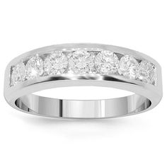 This glamorous womens diamond wedding band is crafted in highly polished 14K White Gold. The center is channel set with seven brilliant round cut diamonds which total to 1.20 carats. The frame measures to 3/16 Inches in width and weighs approximately 6.8 grams. Elegant in appearance, this lovely womens diamond wedding band is an ideal gift for that special someone. $2,011.00