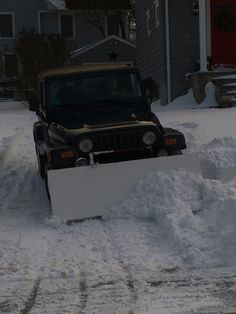 Cleaning up the edges. Chris Hansen · Homemade Snow Plow