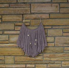 #Sultry Boho-Chic #Lavender Wool Fiber Wall Hanging by #AstralRiles.  --------- DIY fiber wall hangings on http://www.astralriles.com  #macrame #wovenart #vintagemodern #walldecor #fiberwallhangings #hoopart #bohochic #bohemian #southwesterndecor #DIY  #handmade #wool #naturalfibers #walldecor #wallhanging #purple #brasshoop