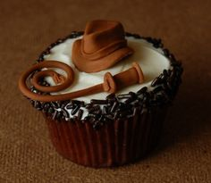 Indiana Jones cupcake on The Mary Sue.  Not sure who made it, but I want one!