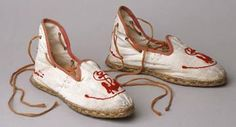 Pair of espadrilles from 1910, made of white linen and embroidered with an anchor motif in red wool. http://www.liverpoolmuseums.org.uk/walker/exhibitions/wardrobe/swimwear/espadrilles.aspx