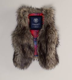 I'm new to the fur vest thing, but I'm thinking my wardrobe needs one soon :)
