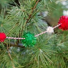 Christmas Tree Decorating Ideas – Pom Pom Garland Craft--easy, peasy--a bag of assorted holiday pompoms and some red and white baker's twine!