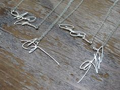 A loved one's signature made into a necklace