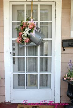 Love This ! DIY Watering Can into Cottage Styled  Door Hanger ! By Concord Cottage (Just switch flowers for seasons! )