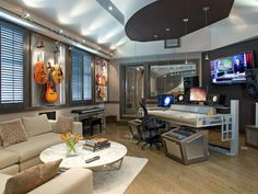High-tech studio equipment, walls of guitars and a contemporary seating area make this home office a great space for work and play.