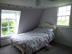 Cottage Bedroom with French bed, Laura Ashley wallpaper and lavender walls